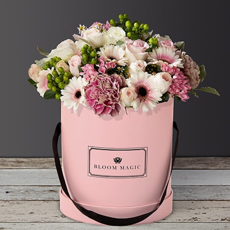 La Vue Du Sacré Cœur Flowers Delivered - La Vue du Sacré Cœur is a wonderful arrangement of roses, gerberas and vintage carnations. This bouquet of flowers set elegantly in a blush hatbox pink hatbox is the perfect gift for someone special.