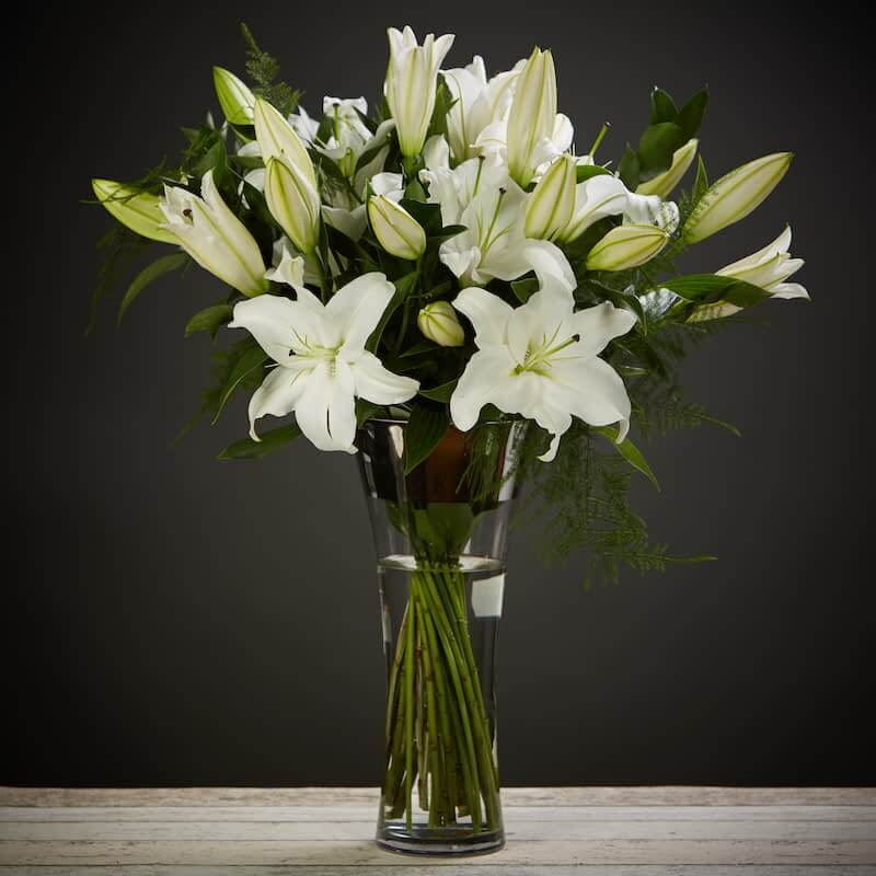 Magical Lilies Flowers Delivered - Bloom Magic - Flower Delivery United Kingdom - An elegant and timeless classic. Scented oriental lilies complimented by lush green foliage. By special request, you can choose from either pink or white lillies. This flower arrangement is designed by the countries top florists. Available for next day delivery nationwide.