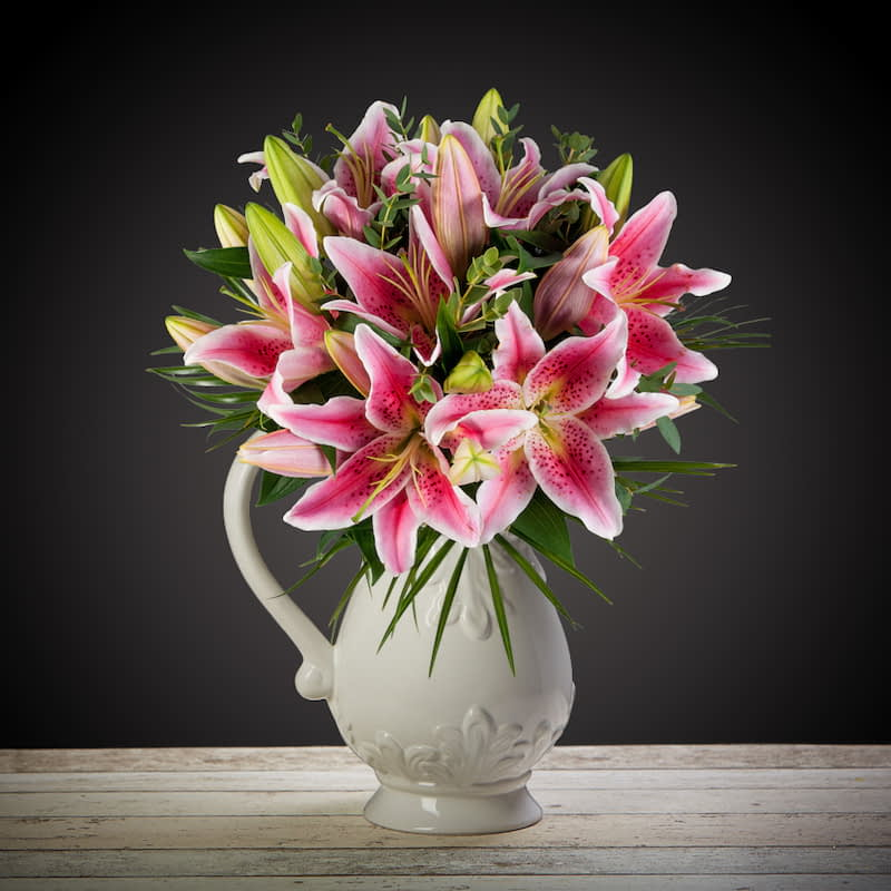 Pink Lily Delight Flowers Delivered - Gorgeous pink lily bouquet perfect for any occasion. This bouquet will surely delight and put a smile on their face. Order this lily bouquet for next day delivery to anywhere in the United Kingdom.