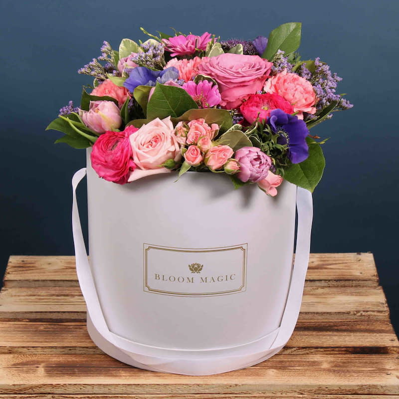 Juliet Flowers Delivered - A wonderful arrangement of hatbox flowers, featuring spray roses and gerbera. This bouquet will wow you Mum this Mother's Day.