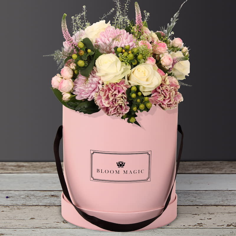 Jardins Du Luxembourg Flowers Delivered - Jardins du Luxembourg is a beautiful arrangement of hatbox flowers featuring spray roses and vintage carnations.