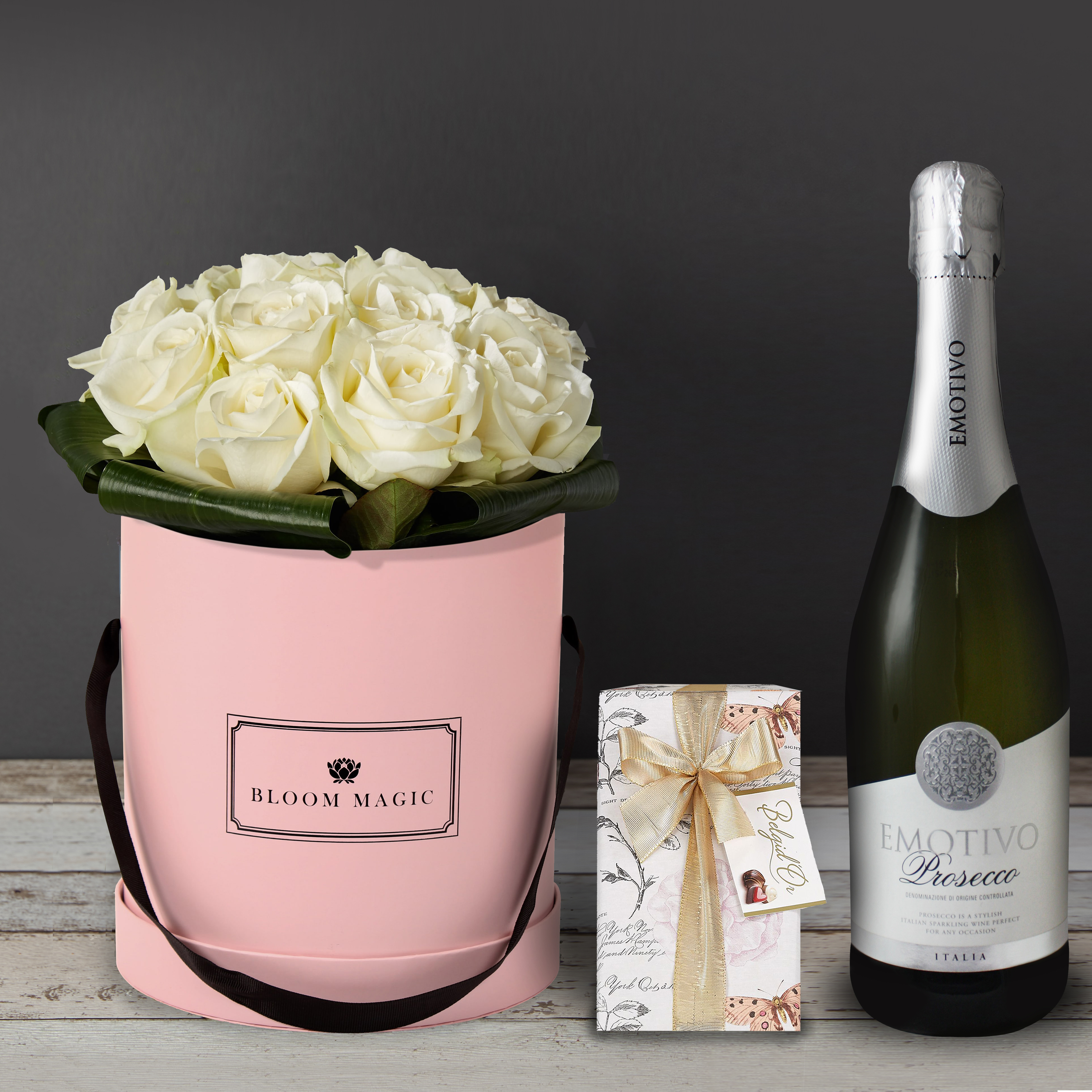 Une Nuit À Montmartre Gift Set Flowers Delivered - Une Nuit À Montmartre is an elegant bouquet of pure white avalanche roses. This arrangement of flowers is perfect for a romantic occasion or a birthday. This can be sent as a sympathy bouquet of flowers as well, and would look more subdued in a charcoal gray hatbox.   Delivery of this bouquet is available to everywhere in the United Kingdom