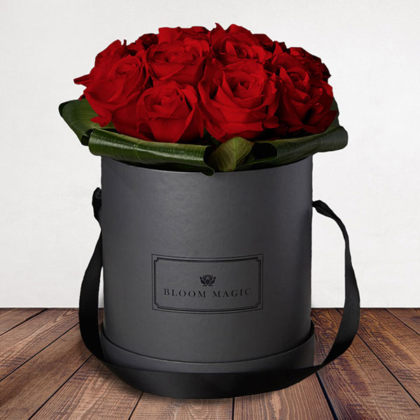Amour Éternel Flowers Delivered - 12 Luxurious Grade A red roses, arranged exquisitely in a charcoal grey Parisian hatbox.