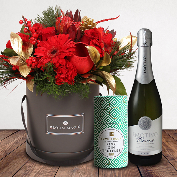 Vixen Gift Set Flowers Delivered - A warm combination of red, greens and gold, festive hatbox is the perfect way to let someone special know you are thinking of them during this festive season. Vixen is part of the Bloom Magic Christmas Collection.  This gift set comes with a bottle of Italian prosecco and a box of 175g gift wrapped Belgian chocolates