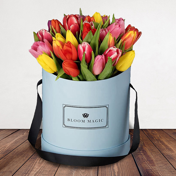 Le Printemps Flowers Delivered - A delightful hatbox packed with tulips and spring colours. This elegant gift would make your loved one's heart swell on Valentines Day. A perfect alternative to roses that they are sure to remember for years to come!