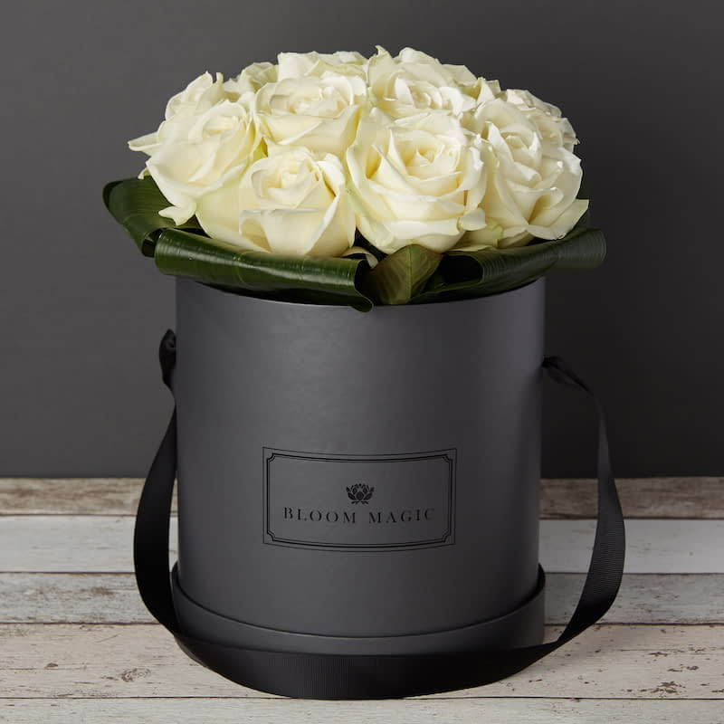 La Nuit Blanche Flowers Delivered - Bloom Magic - Flower Delivery United Kingdom - A stunning flower arrangement of top quality white roses, that come in either a charcoal grey, or powder blue hat box. These romantic flowers were inspired by the white night in Paris, and that makes them the perfect gift for any loved one. Order these flowers for next day delivery to anywhere in England and the UK.