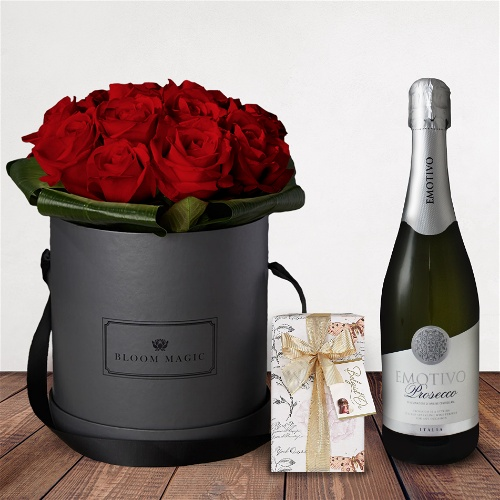 """Amour Éternel Gift Set Flowers Delivered - What could be more romantic than an elegant hatbox of Valentine's blooms? The """"Amour Éternel"""" is one of our signature hatbox of the 2018 Valentines collection. This luxury hatbox of Grade A roses will amaze your loved one and will create a memory to last a lifetime  Valentines is very busy and supplies of each product are limited. Order early to avoid disappointment."""