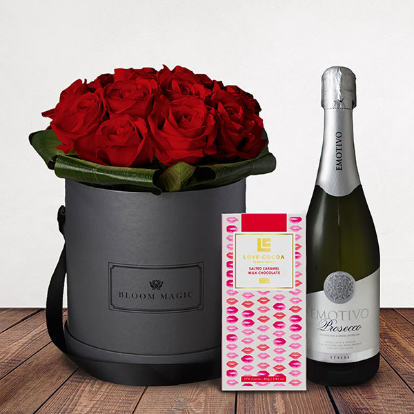 Amour Éternel Gift Set Flowers Delivered - This luxury hatbox of Grade A roses will amaze your loved one and will create a memory to last a lifetime. Giftset comes complete with a bottle of prosecco as well as a luxury Love Cocoa Salted Caramel Chocolate Bar.
