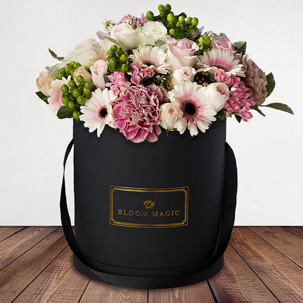 Aux Champs-Élysées Flowers Delivered - A winning combination of pink and green flowers, presented in your choice of a pearl white or matte black hatbox. Perfect for any room or occasion, this stunning flower arrangement is sure to receive a lot of compliments.