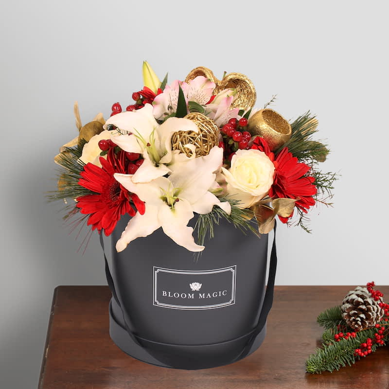 Donner Flowers Delivered - The Donner holiday hatbox arrangement is sure to bring festive cheer to any home. Filled with gorgeous seasonal blooms in festive tones, this is a lovely gift this Christmas season