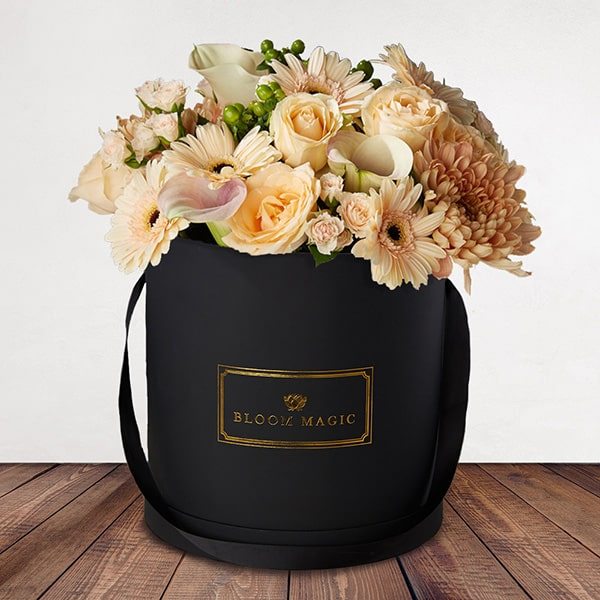 Bloom Magic - Flower Delivery United Kingdom - This bouquet screams white, and would brighten up any home or day. This arrangement comes in a pearl white, or matte black hatbox. It features white calla lilies, and white roses, that are hand tied by some of the country's top florists.  This stunning hatbox bouquet is available for delivery to everywhere in the United Kingdom.