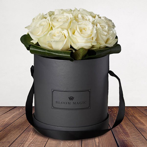 Bloom Magic - Flower Delivery United Kingdom - A stunning flower arrangement of top quality white roses, that come in either a charcoal grey, or powder blue hat box. These romantic flowers were inspired by the white night in Paris, and that makes them the perfect gift for any loved one. Order these flowers for next day delivery to anywhere in England and the UK.