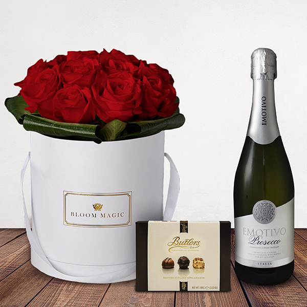 Mon Amour Gift Set Flowers Delivered - What could be more romantic than an elegant hatbox of Grade A Dutch red roses? The Mon Amour is one of our signature romantic hatboxes. This luxury arrangement will amaze your loved one and will create a memory to last a lifetime.  This gift set comes with a bottle of Italian prosecco and luxury Butlers chocolates.   Note: On delivery, you may notice some tougher, slightly browned petals around the outside of your roses or other flowers. Rest assured, the flowers are fresh!These are called 'storm petals' which we intentionally leave on to protect the delicate inner flower when in transit. To reveal the fresh inner petals, gently remove the 3/4 storm petals by pulling them at the base