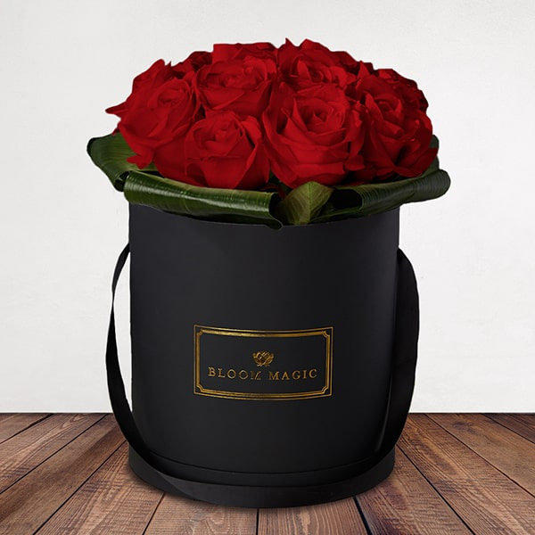 Mon Amour Flowers Delivered - What could be more romantic than an elegant hatbox of Grade A Dutch red roses? The Mon Amour is one of our signature romantic hatboxes. This luxury arrangement will amaze your loved one and will create a memory to last a lifetime.