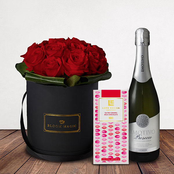"Mon Amour Gift Set Flowers Delivered - The ""Mon Amour"" is our signature hatbox of the Valentines and Romance collection. It's a modern twist on Valentine's flower feature greens and pinks to give it a distinctive and original flare."