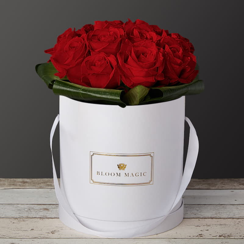 "Mon Amour Flowers Delivered - The ""Mon Amour"" is our signature hatbox of the Valentines and Romance collection. It's a modern twist on Valentine's flower feature greens and pinks to give it a distinctive and original flare. Delivery is available to everywhere in the United Kingdom."
