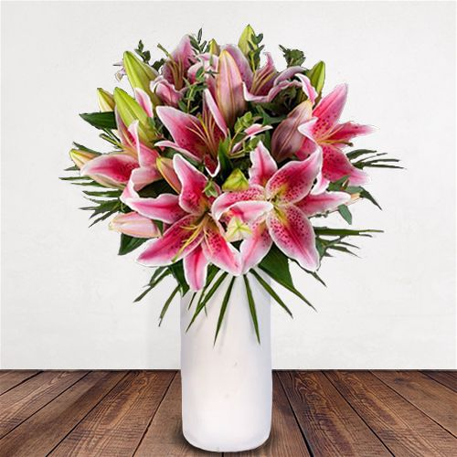 Pink Lily Delight Flowers Delivered - An elegant and timeless classic. Scented pink oriental lilies complimented by lush green foliage. This bouquet is perfect for any occasion and would brighten any room.   Vase Not Included