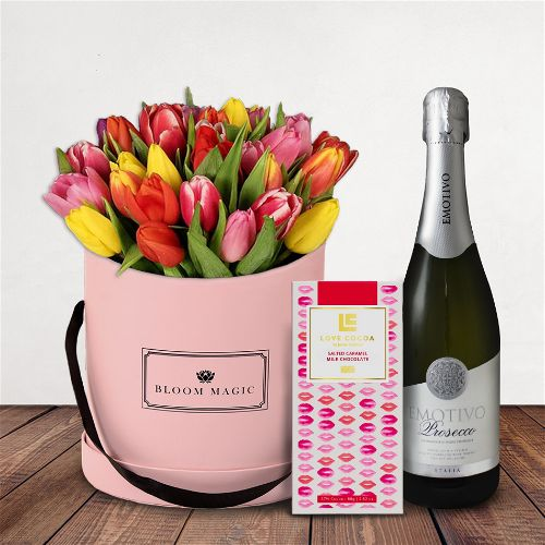 Le Printemps Gift Set Flowers Delivered - A delightful hatbox packed with tulips and spring colours. This elegant gift would make your loved one's heart swell on Valentines Day. A perfect alternative to roses that they are sure to remember for years to come!