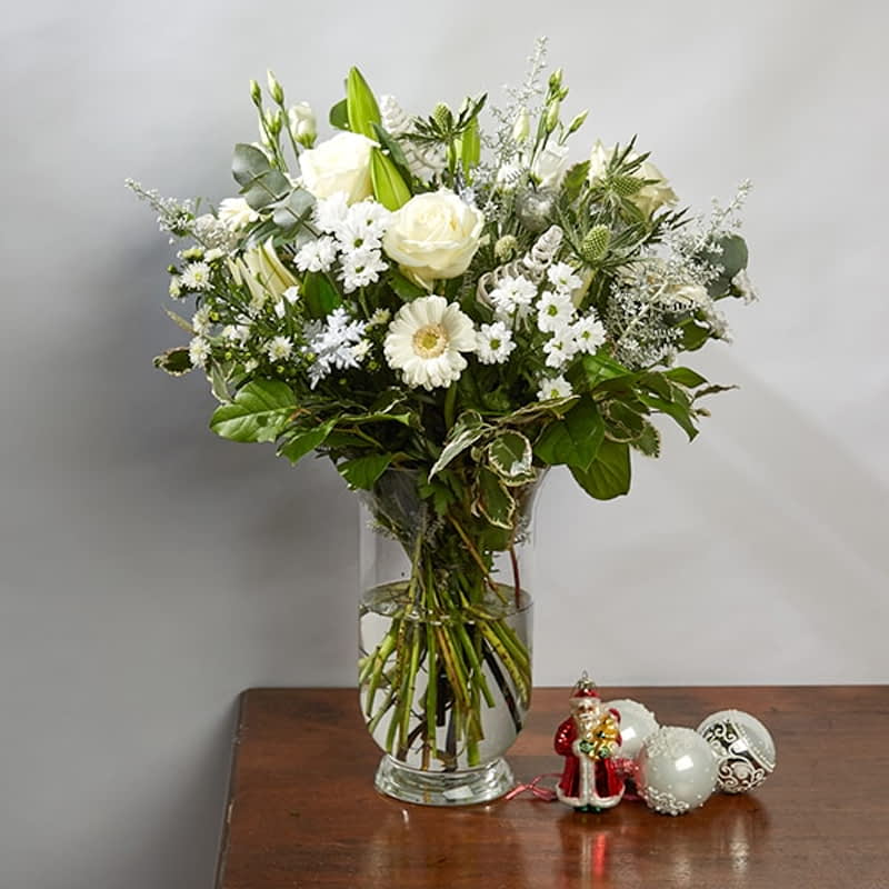 Prancer Flowers Delivered - A combination of snowy whites and fresh greens will be an elegant addition to your household this holiday season. A bouquet that would even impress Mrs. Claus. 