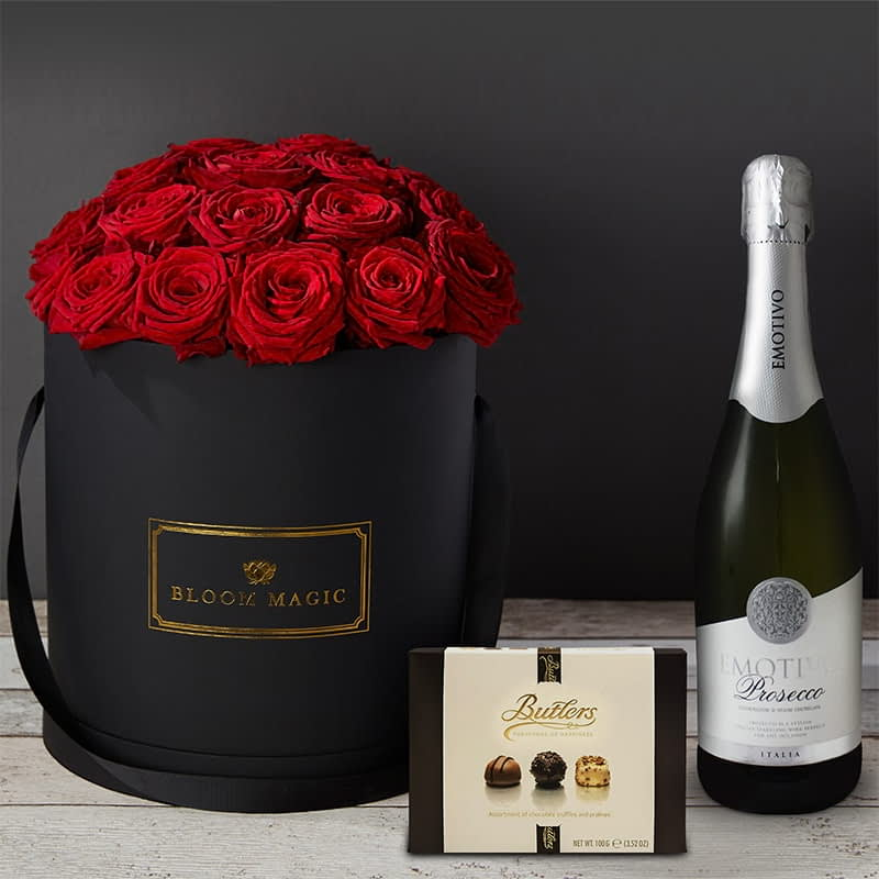 Romance Sur La Seine Gift Set Flowers Delivered - Bloom Magic - Flower Delivery United Kingdom - This hatbox flower arrangement features stunning red roses immaculately arrange and presented in a choice of either a matte black or pearl white large hatbox. this arrangement is the perfect gift, especially if you are looking for some Valentine's flowers to make that someone special feel amazing. We offer same day delivery for this arrangement to anywhere in London, and next day delivery to anywhere in the United Kingdom.