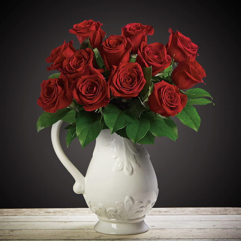 Roses With Love Flowers Delivered - Bloom Magic - Flower Delivery United Kingdom - What's more special than receiving the classic gift of one dozen luxurious roses? Long stemmed Grade A roses, expertly hand-tied and gift wrapped are sure to make your special someone feel amazing.