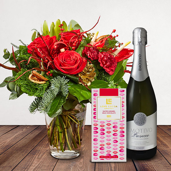 Rudolph Gift Set Flowers Delivered - This fun and festive bouquet is sure to bring smiles this Christmas. With warm red tones and a little sparkle, this is the perfect arrangement to let someone know they're in your thoughts this season. Rudolph is part of the Bloom Magic Christmas Collection.