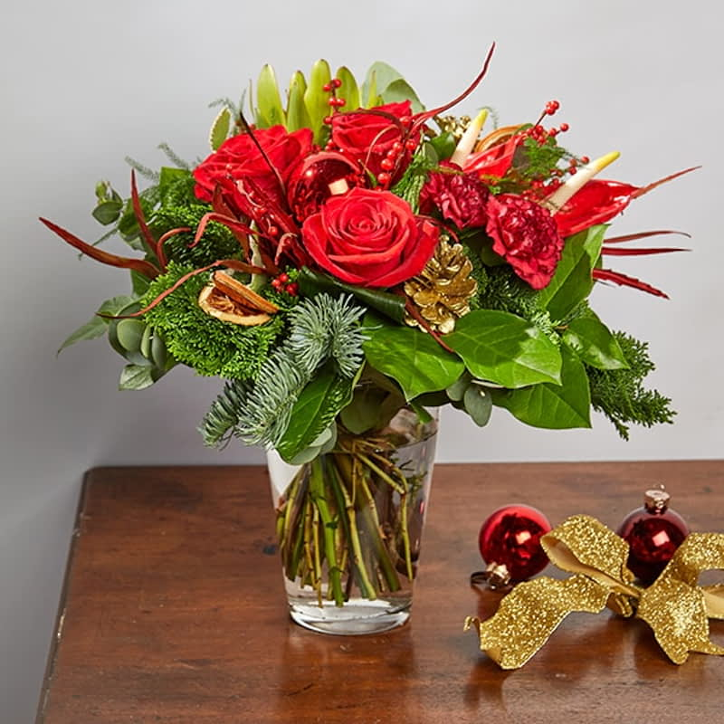 Rudolph Flowers Delivered - This fun and festive bouquet is sure to bring smiles this Christmas. With warm red tones and a little sparkle, this is the perfect arrangement to let someone know they're in your thoughts this season. 