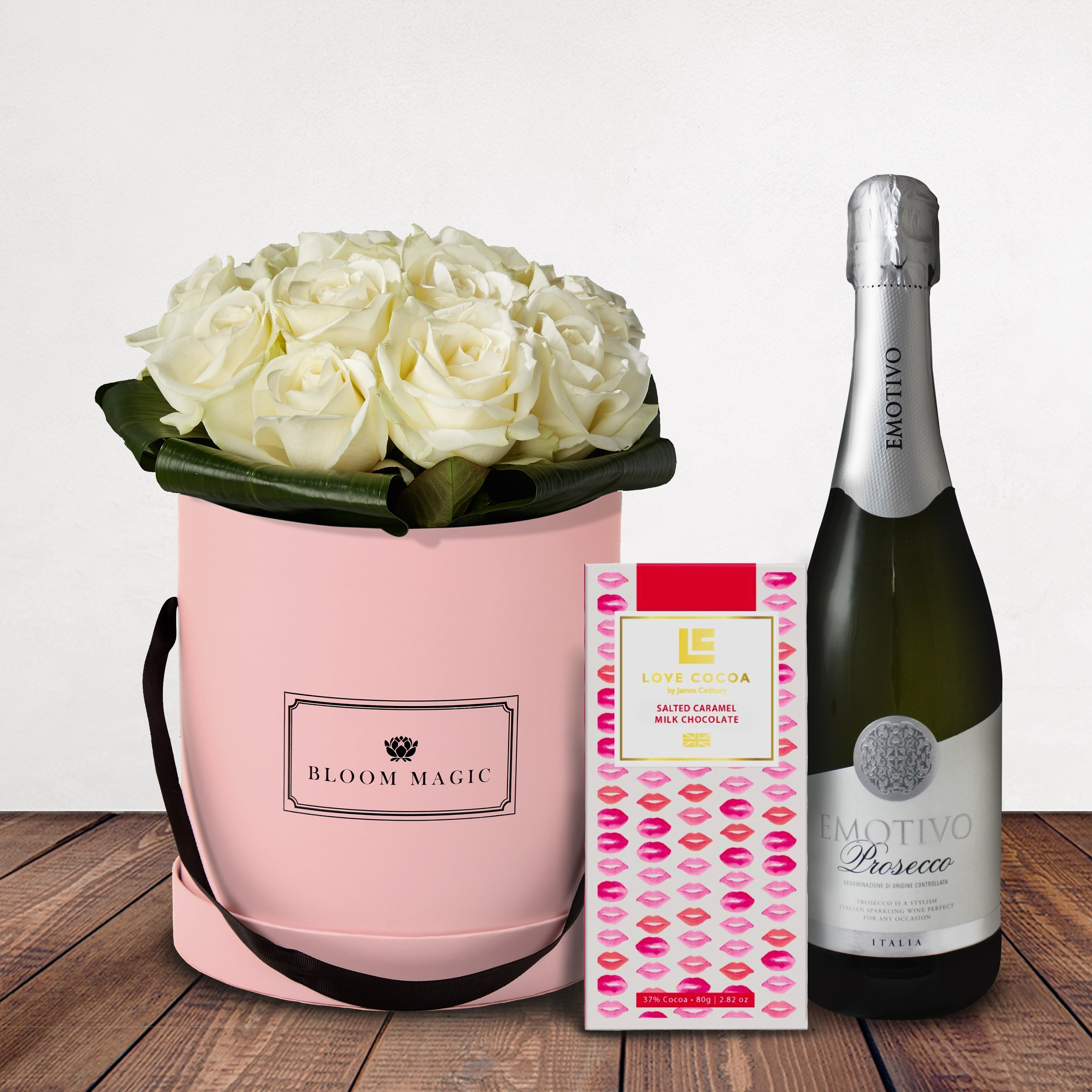 Une Nuit À Montmartre Gift Set Flowers Delivered - Une Nuit À Montmartre is a beautiful selection of top quality white avalanche roses that comes in a blush pink, charcoal grey or powder blue hat box. This is a beautiful and classy flower arrangement would make a perfect gift for any loved one. It's can be romantic or just classically elegant, so whatever the occasion this is the perfect bouquet to put a smile on their face.