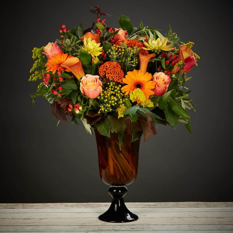 Autumn Leaves Flowers Delivered - A gorgeous mix of warm autumn colours. A striking and vibrant bouquet.    No two bouquet are ever the same so each and every bouquet is bespoke and truly unique. The picture shows an example of our bouquet with yours containing seasonal flowers similar in colour, texture and vibrancy.    Vase Not Included