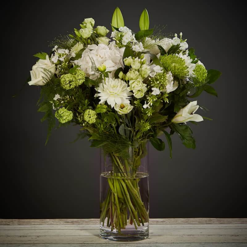 Blooming Whites Flowers Delivered - A classic combination of white and green seasonal flowers. Elegant and fresh, a perfect choice for any occasion.    No two bouquet are ever the same so each and every bouquet is bespoke and truly unique. The picture shows an example of our bouquet with yours containing seasonal flowers similar in colour, texture and vibrancy.    Vase Not Included