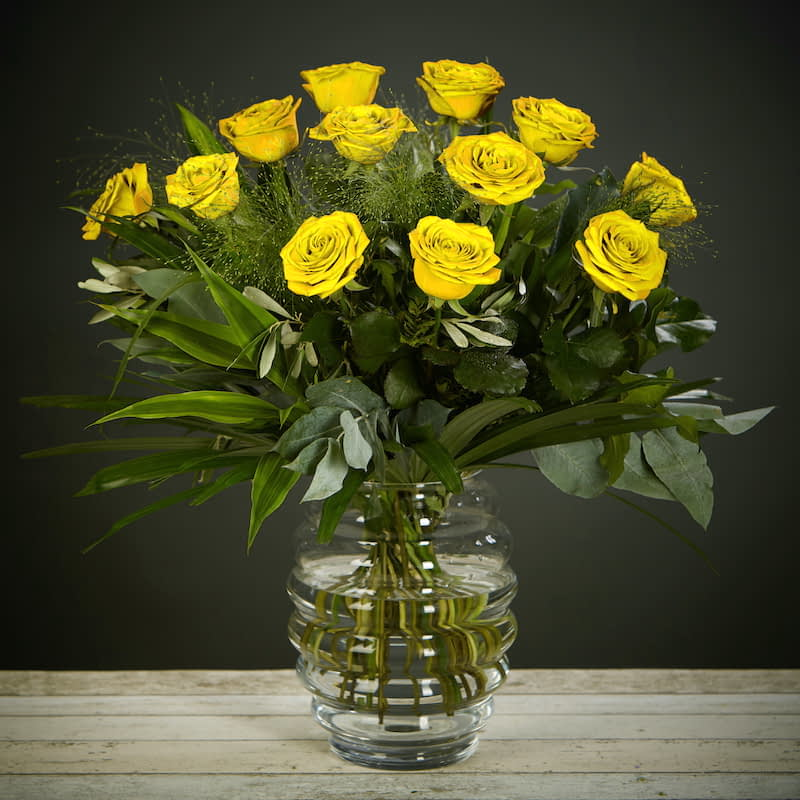 """Yellow Rose Delight Flowers Delivered - """"What's more special than receiving the classic gift of one dozen luxurious roses? Long stemmed Grade A roses, expertly hand-tied and gift wrapped are sure to make your special someone feel amazing. Choose from ½ dozen, 1 or 2 dozen in different colours.    Vase Not Included"""""""