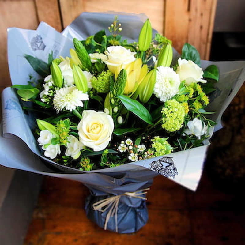 Athena Flowers Delivered - A classic combination of white and green seasonal flowers that gives off a country garden flower feel. Elegant and fresh, a perfect choice for any occasion.  No two bouquet are ever the same so each and every bouquet is bespoke and truly unique. The picture shows an example of our bouquet with yours containing seasonal flowers similar in colour, texture and vibrancy.
