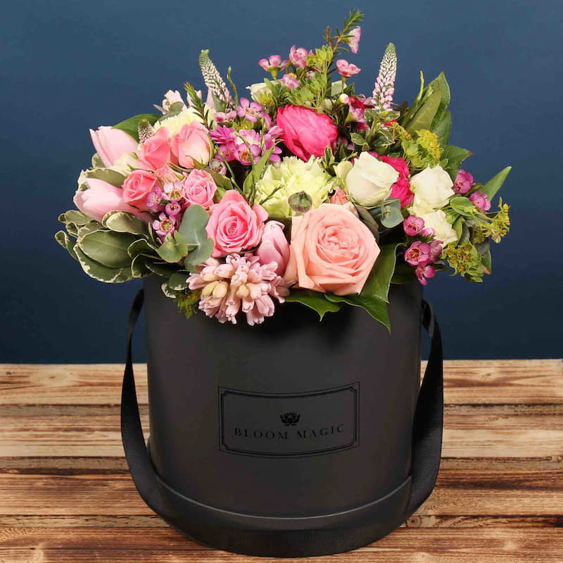 Ophelia Flowers Delivered - Looking for the perfect Mothers Day Gift? This charcoal grey hatbox filled with a mixture of pink roses and tulips make it stunning arrangement that looks luxurious in any home.