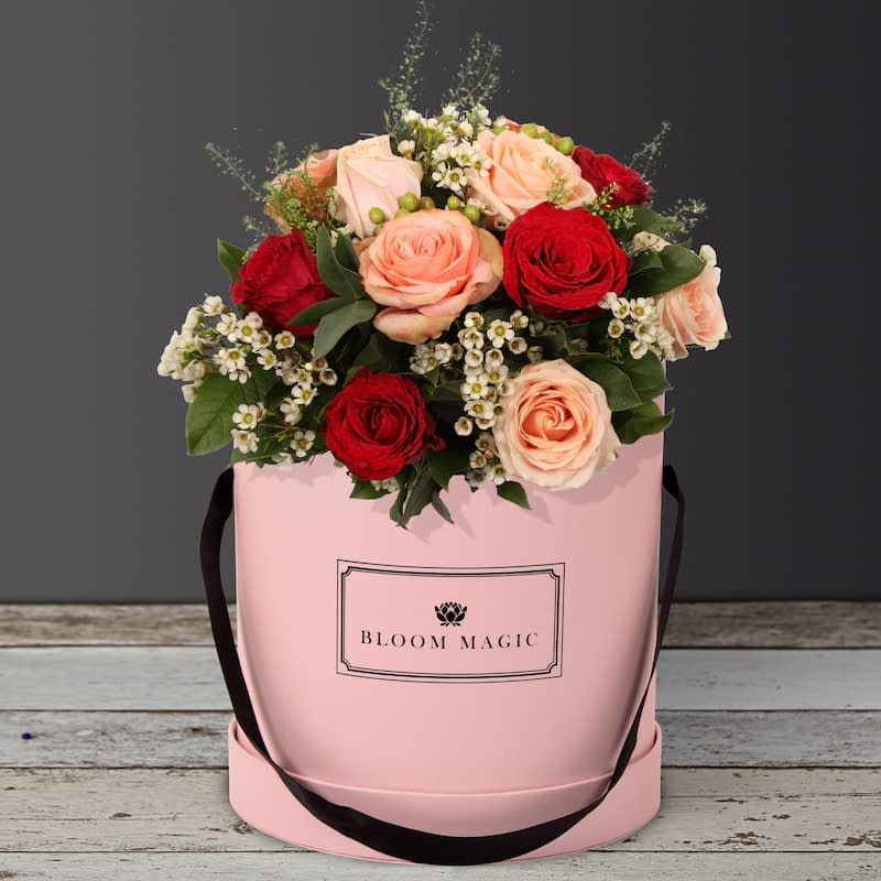 Danser Au Moulin Rouge Flowers Delivered - Danser au Moulin Rouge is a sweet arrangement of luxurious roses set in our fabulous blush pink hatbox. This bouquet can also be paired with a charcoal gray hatbox or a powder blue hatbox.  Danser au Moulin Rouge is a perfect bouquet of flowers for a romantic occasion or for a birthday.