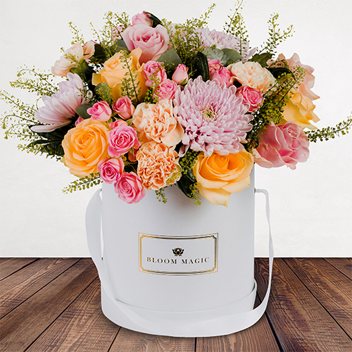 Parc Floral De Paris Flowers Delivered - A striking combination of  peach carnations and pale rose mix. 'Parc floral de Paris' is a sweet pastel bouquet artfully arranged to create that perfect thank you gift or to simply celebrate a special milestone.