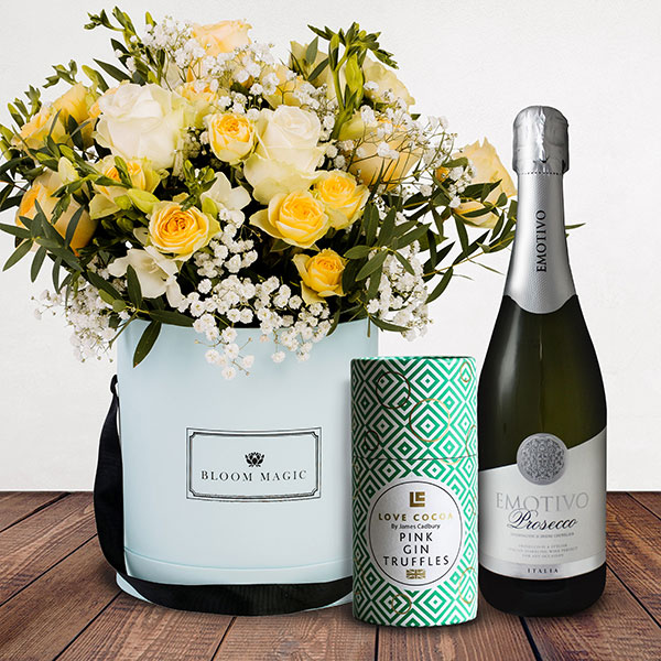 Bonjour Mon Ami Gift Set Flowers Delivered - White & butter roses arranged with cream freesia create this unique and blossoming bouquet. Stand out from the crowd and send these delightful blooms to loved ones to show them just how much you care. Whatever the occasion, the 'Bonjour Mon Ami' is the perfect pick me up. The giftset comes complete with a bottle of prosecco as well as luxury Love Cocoa pink gin truffles.