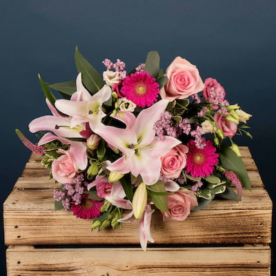 This precious flower bouquet is ideal for any occasion. The Pink colours from the Lily's, Lisianthus, and Roses, pop out making this a glowing handtied arrangement. We offer next day flower delivery to London or to anywhere in the UK.