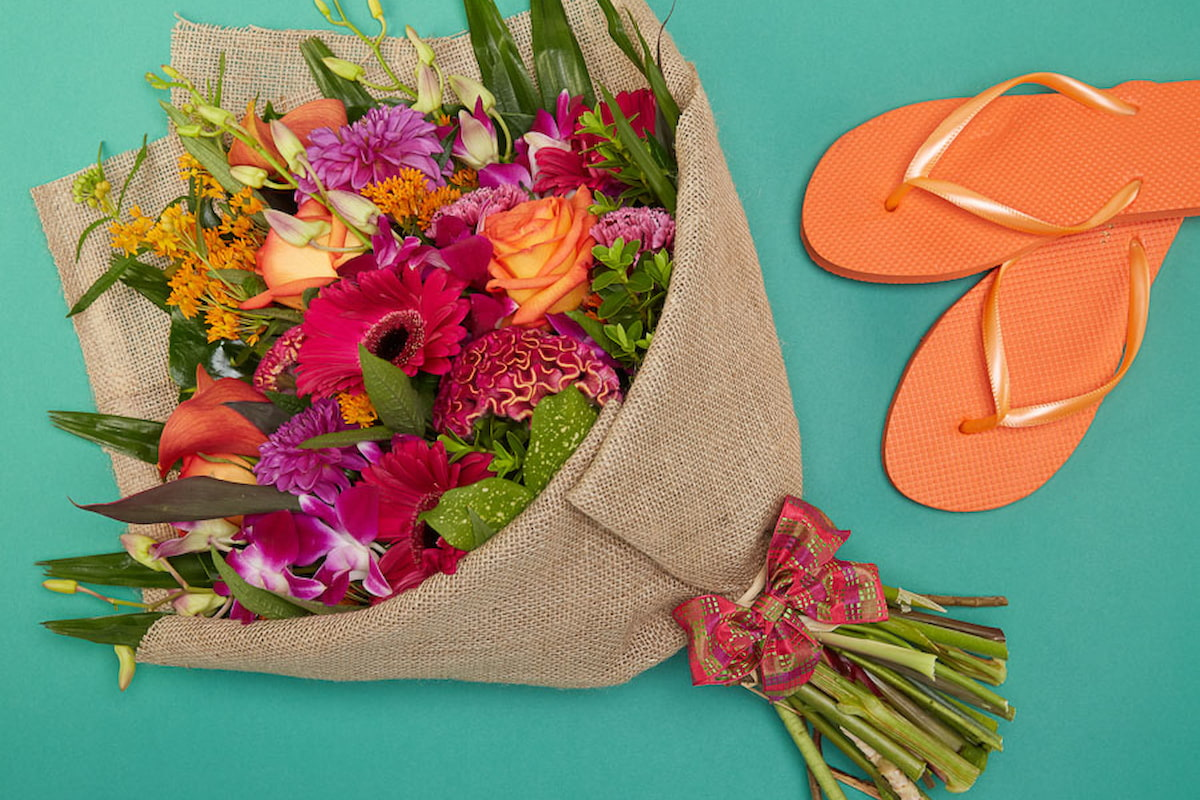 Bloom Magic - Flower Delivery Ireland - A fun and carefree bouquet of orange roses, pink calla lillies and pink orchids. These flowers will be sure to pleaes for any occasion, whether a birthday or a thank-you gift. Flower delivery to Dublin is available