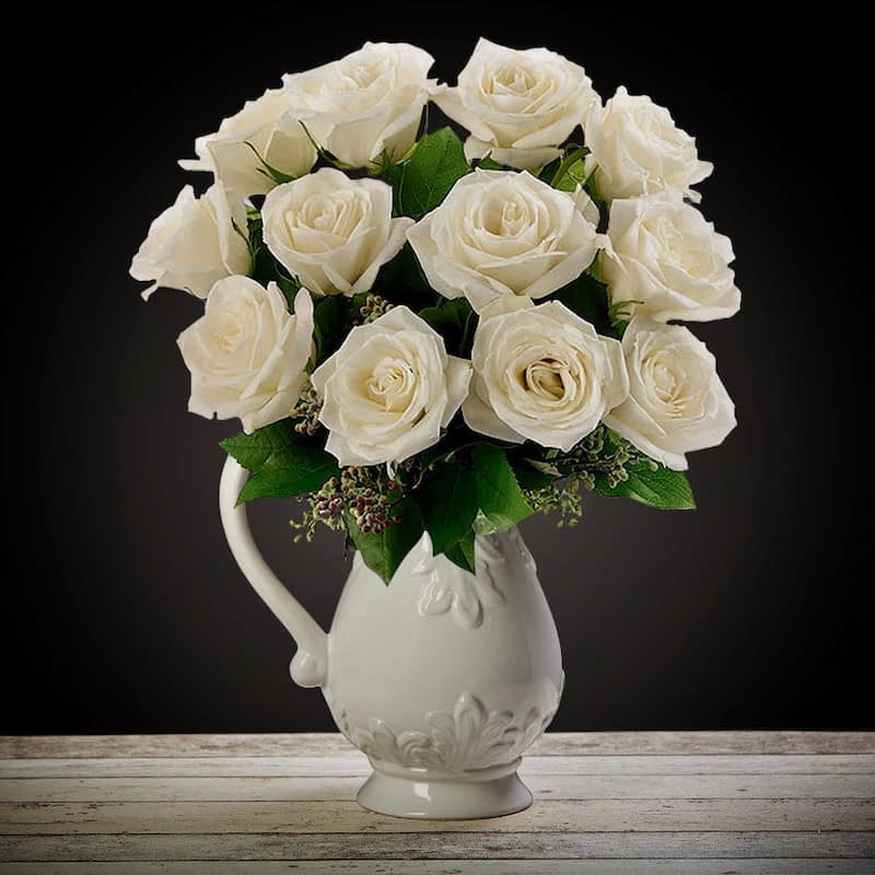 Bloom Magic - Flower Delivery Ireland - What's more special than receiving the classic gift of one dozen luxurious white roses? Long stemmed Grade A roses are perfectly suitable for birthday flowers, romantic flowers, engagement flowers, or even just beca