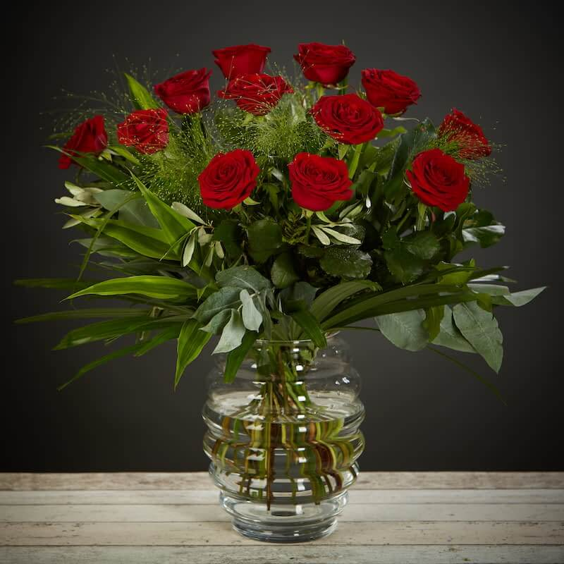 Roses With Love Flowers Delivered - What's more special than receiving the classic gift of one dozen luxurious roses? Long stemmed Grade A roses, expertly hand-tied and gift wrapped are sure to make your special someone feel amazing.