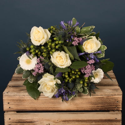 This bouquet of flowers features lavender and blue tones, with large avalanche roses featuring prominently. A wonderful bouquet for any occasion. The Vanilla Sky