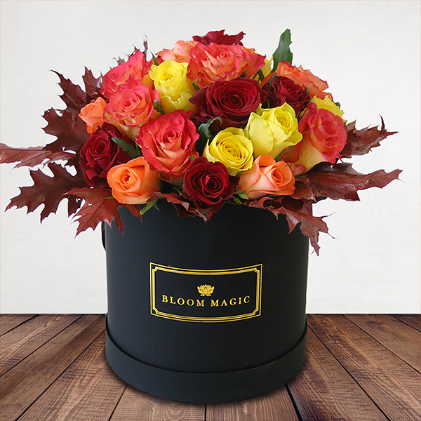 Automne J'adore Flowers Delivered - New! Our 'Automne j'adore' hatbox is a beautiful mix of yellow, orange, red and peach roses, complemented perfectly with red oak leaf. A warm addition to any home and the perfect gift this Autumn, reserve yours before it's too late!