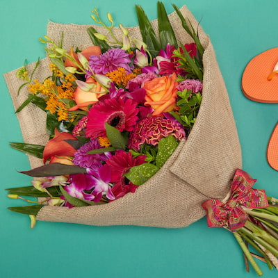 """Venice Beach Sunset Flowers Delivered - """"All the joys of summer in one bouquet: Hot pinks and vibrant oranges make for a super fun and expressive bouquet of flowers.   No two bouquet are ever the same so each and every bouquet is bespoke and truly unique. The picture shows an example of our bouquet with yours containing seasonal flowers similar in colour, texture and vibrancy."""""""