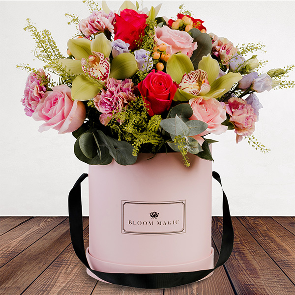 La Vie Est Belle Flowers Delivered - Our florists choice for those seeking a passionate bouquet. This blossoming arrangement of pale pink & cerise rose, peach hypericum & green orchid is a truly unique gift. Certain to make them feel cherished. 