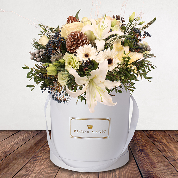 Let It Snow Flowers Delivered - A gorgeous seasonal arrangement of snow whites and blue winter berries. This bouquet is reminiscent of a snowy Christmas morning and would be a lovely addition to any room this holiday season.