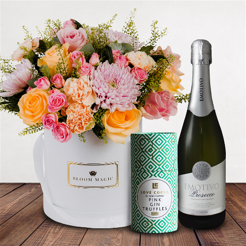 Parc Floral De Paris Gift Set Flowers Delivered - A striking combination of peach carnations and pale rose mix. 'Parc floral de Paris' is a sweet pastel bouquet artfully arranged to create that perfect thank you gift or to simply celebrate a special milestone.  The 'Parc floral de Paris' giftset comes complete with a bottle of prosecco as well as luxury Love Cocoa pink gin truffles.