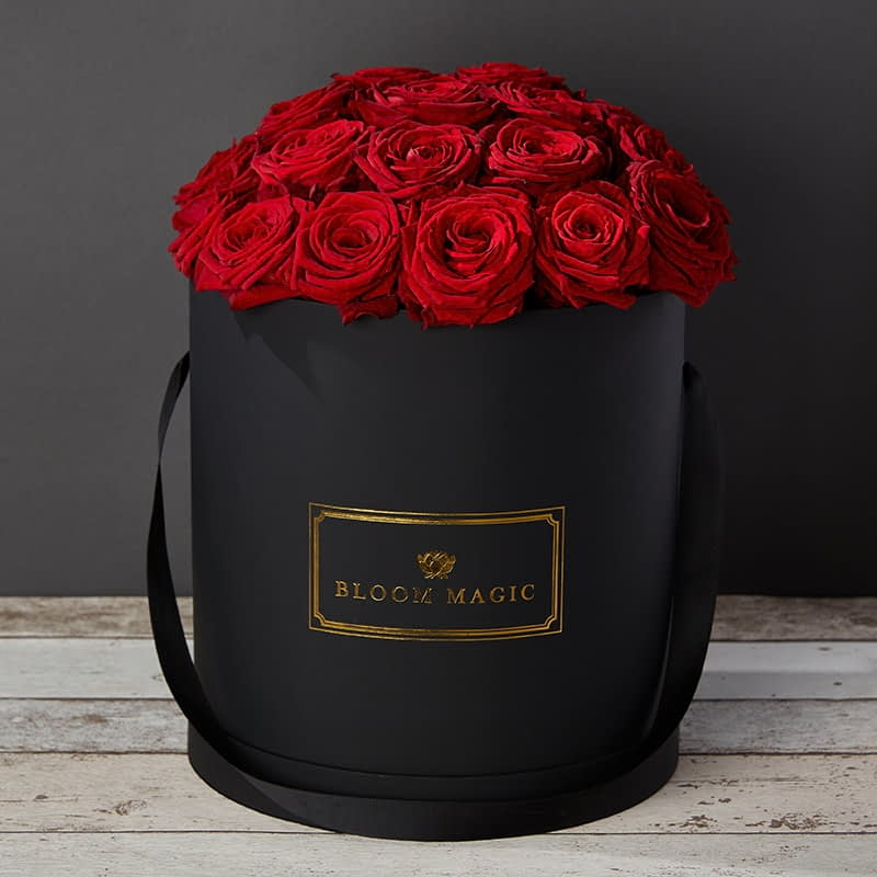 Bloom Magic - Flower Delivery Ireland - This hatbox flower arrangement features stunning red roses immaculately arrange and presented in a choice of either a matte black or pearl white large hatbox. this arrangement is the perfect gift, especially if you