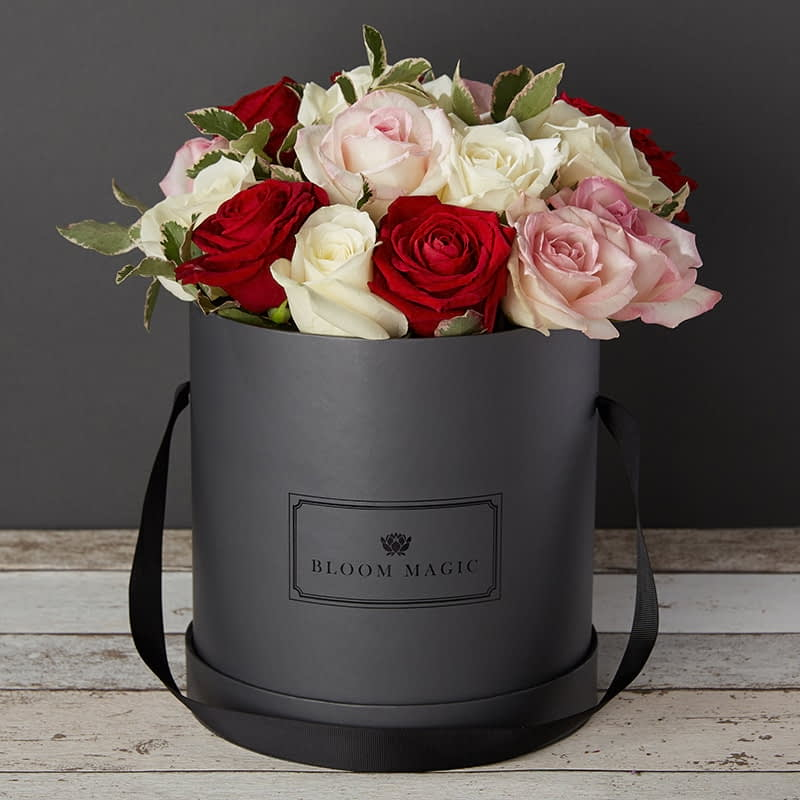 Bloom Magic - Flower Delivery Ireland - A vibrant bouquet containing a mixture of red and white roses. This flower arrangment comes in either a charcoal grey, or powder blue hatbox, and is perfect for any occasion. Same day flower delivery is available to