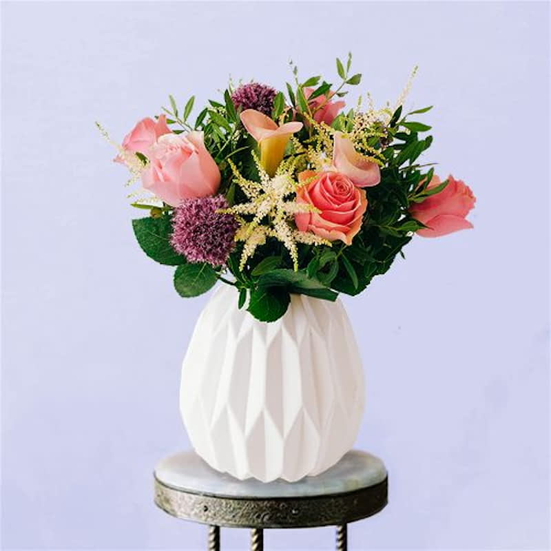 The Covent Garden Flowers Delivered - Fashionable, aromatic and artfully arranged, The Covent Garden is without a doubt one of our favourites in the London Collection and perfect for that big romantic gesture. With pale pink lilies & irresistible mini purple allium, this bouquet is guaranteed to take anyone's breath away.